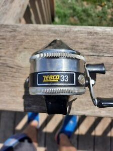 Vintage Zebco Spincast Model 33 metal foot casting reel made in USA. Works. Nice