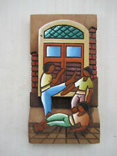 50 year old carved wooden wall art from Brazil - martial arts with 3 figures