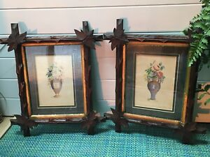 TWO ANTIQUE HAND COLORED ENGRAVINGS FLORAL W/BLACK FOREST FRAMES GILDED