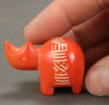 Itty bitty soapstone rhino - Orange - Hand carved in Kenya - Rhinoceros.
