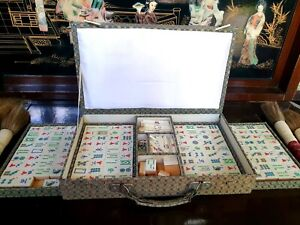 70 year old Mahjong set with hand carved bone and bamboo pieces in silk box