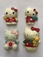 Four Hello Kitty Refrigerator Magnets
