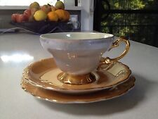 Tea cup, saucer and plate in pastel orange with gilded edges, Japan