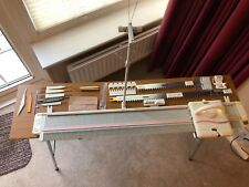 Silver Reed LK-150 Knitting Machine - Hardly Used, with accessories and table