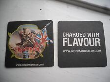 A pair of Iron Maiden beer mats