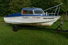 16ft fiberglass Microplus fishing boat with 20hp Johnson outboard and trailer.