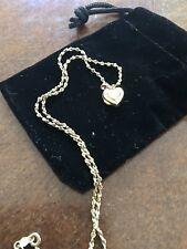 "14k Yellow Gold Diamond Cut Necklace And 14k Miniature Heart Locket. 15"" Length"