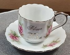 SILVER 25TH ANNIVERSARY CUP & SAUCER WITH PINK ROSE AND SILVER ACCENT BY ENESCO