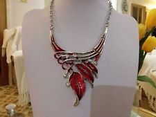 Brand new silver statement necklace with red enamal leaves and crystals