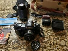 Canon T50 35mm Slr Film Camera W/case, flash, manuals, and zoom lens