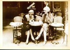 POST CARD OF TWO GIRLS AT A SIDEWALK CAFE IN PARIS