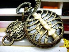 golden face steampunk pocket watch necklace. Antique bronze Wolf head charm bone