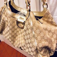 Authentic Gucci Sukey Handbag with Gold Leather Trim and Gold Tone Hardwares
