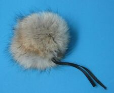FUR POMPOMS MADE FROM COYOTE FUR