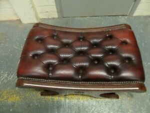 A Oxblood Leather Chesterfield Saddle Foot Stool