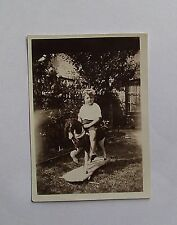 1930s B/W Photograph.Little Boy on a Rocking Horse in the Garden. Childhood