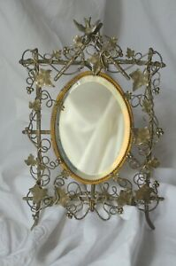 Antique French ornate bronze and silver coated mirror, bird vine and tendrils