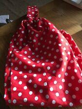 Handmade red and white polka dot carrier bag holder