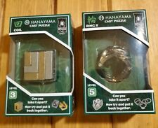 Hanayama Cast Puzzle Level 3 Coil, Level 5 Ring 2.   Lot of 2 New Sealed!