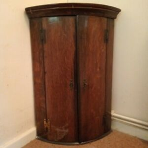"""Corner cupboard. Height 27"""". Depth 13.5"""" Two shelves Used. Unwanted gift."""