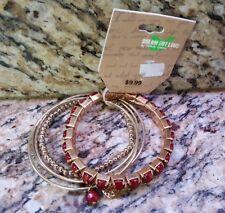 5 Piece Bracelet Set Dream out Loud by Selena Gomez Gold color w/ Dark Red NEW