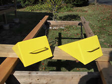 CHOCK BLOCKS, WELDED HEAVY DUTY STEEL WITH HANDLE. YELLOW,  BY THE PAIR.