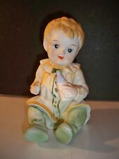 PORCELAIN PIANO  BABY WITH BABY BOTTLE HAND PAINTED  7''