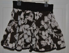 NEW BROWN AND WHITE FLARE FLORAL LINED SKIRT. SIZE LARGE