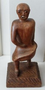 Large wooden male skirted sculpture figure