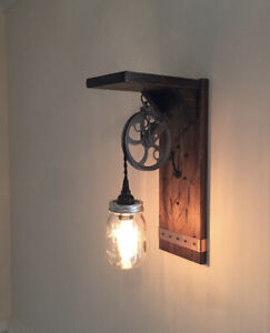 Rustic wall sconce light with mason jar and pulley. Steampunk farmhouse style