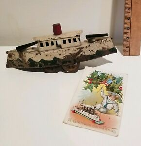 Antique Painted Tin Ship Boat on Wheels  Germany & Christmas Postcard 1909