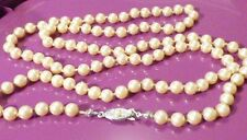 #88--SIGNED CLASP 'JAPAN' INDIVIDUALLY KNOTTED FAUX PEARL NECKLACE