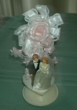 1985 BRIDE AND GROOM WEDDING CAKE TOPPER WITH PINK ACCENTS' 10.5 'VG