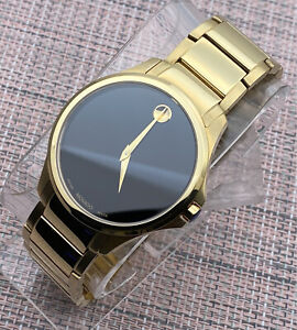 B. New Movado Ario 18K Gold Plated Stainless Steel Model # 0607448 Men's Watch