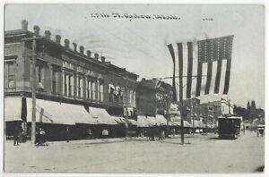 1909 Ogden, Utah - Main Street, Storefronts, Railroad Trolley, American Flag