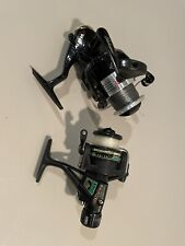 Two Spinning Reels And Bass Pro Reel Tote
