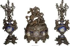 A Three-Piece Renaissance Revival Patinated And Enameled Metal Cloc. Lot 65950