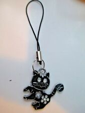 A LUCKY ENAMELLED BLACK CAT PHONE OR BAG CHARM ON BLACK CORD.. GREAT LITTLE GIFT