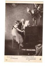 ANTIQUE POSTCARD LA LECON DE CLAVECIN BY J.A. MUENIER LITTLE GIRL PLAYING PIANO