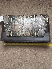 bfbfb145df6d Banana Republic Faux Leather Clutch Handbags   Purses