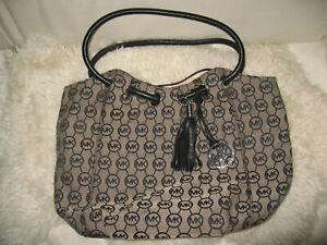 Michael Kors tan canvas MK logo & black Leather Handbag tote silver hardware