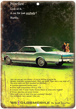 "1965 Oldsmobile Starfire Car Ad 10"" x 7""  Reproduction Metal Sign"