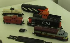 HO SCALE TRAIN SET WITH ENGINES, CARS, TRACK, BUILDINGS AND TRANSFORMER