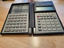 vintage calculator HP 28s with book