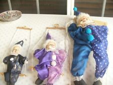 THREE VERY OLD PUPPETS EACH A DIFFERENT SIZE,FACE COULD BE PORCLAIN BUT NOT SURE