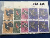 Switzerland Pro Juventute sets in blocks of 4 with edges and First Day postmark