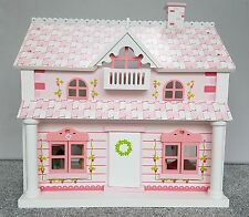 Lovely wooden dolls house with furniture and little dolls - white and pink