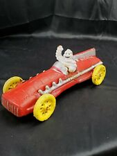 Michelin Man Bibendum OLD Vintage Cast Iron Red Race Car from the 1930s Nice con