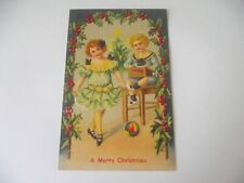 ANTIQUE POSTCARD 1907 MERRY CHRISTMAS BOY GIRL HOLLY TOYS EMBOSSED