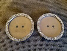 PAIR OF SMALL ROUND DECORATIVE PICTURE FRAMES.  D: 8.5cm.